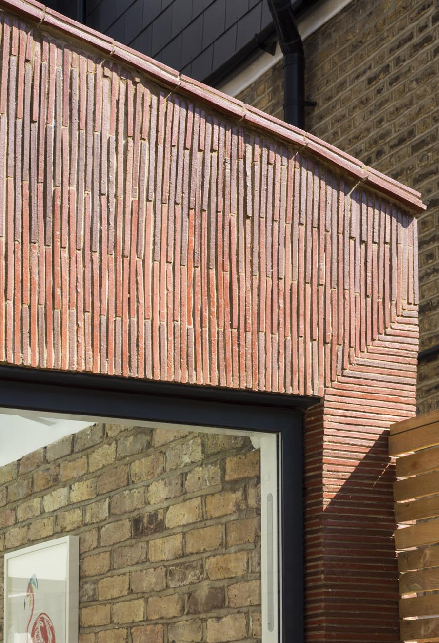 Stacked creasing tiles clad new extension in London
