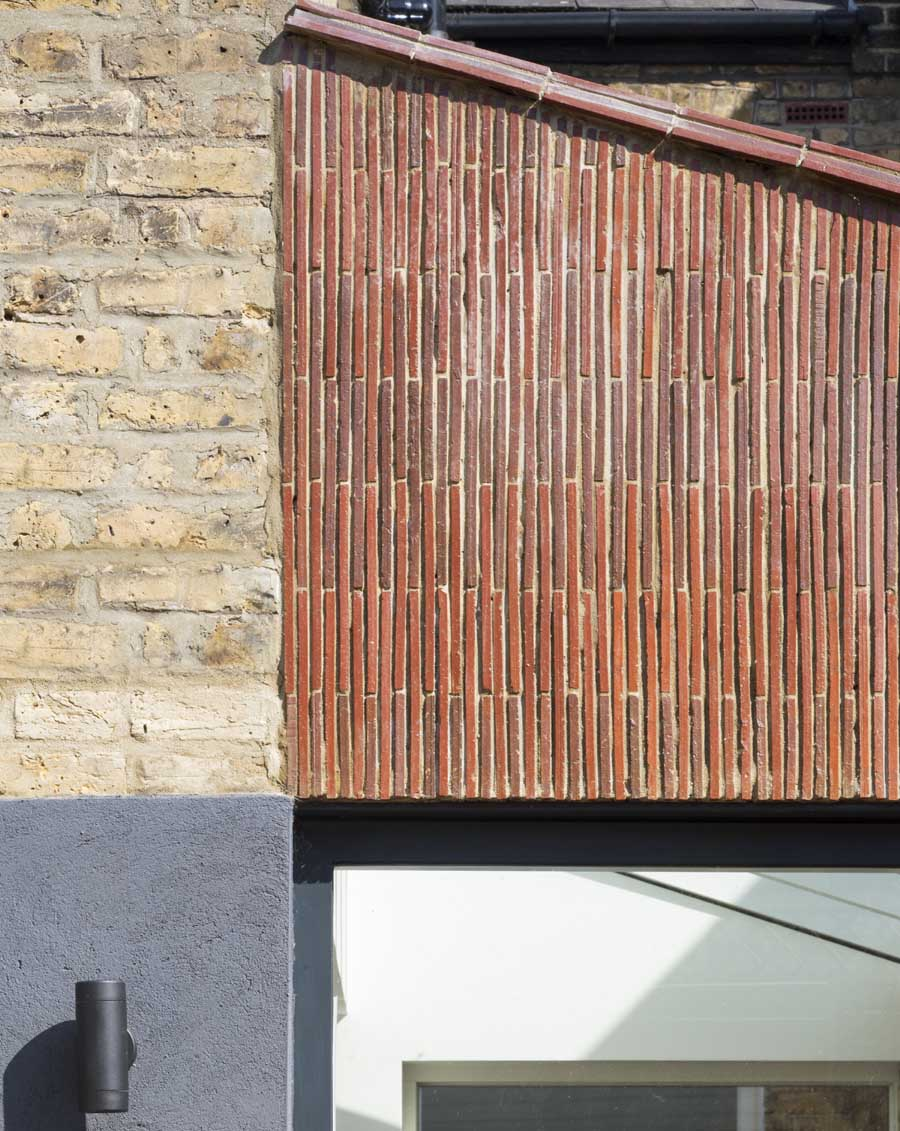 Stacked creasing tiles clad new extension