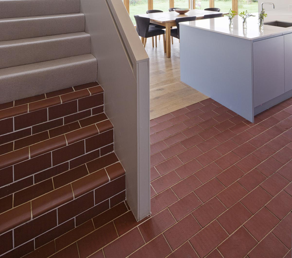 Staffs red rectangular quarry tiles laid over underfloor heating
