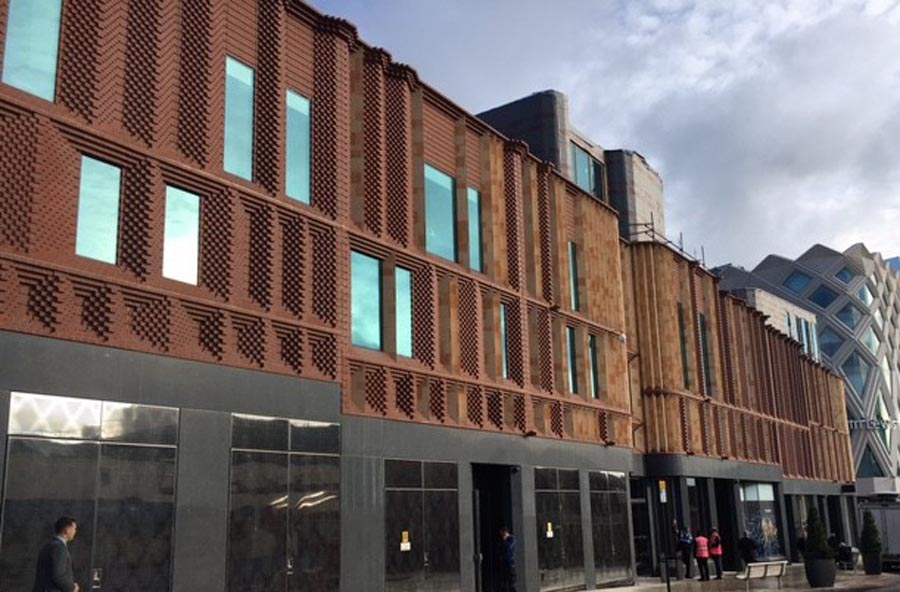 Victoria Gate Arcade in Leeds with precast panels faced withKetley Staffs red bricks and specials