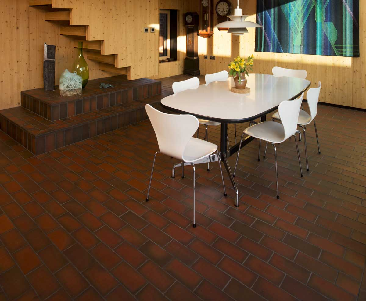 a blend of dark and light multi quarry tiles at a Passiv house in Hampshrie