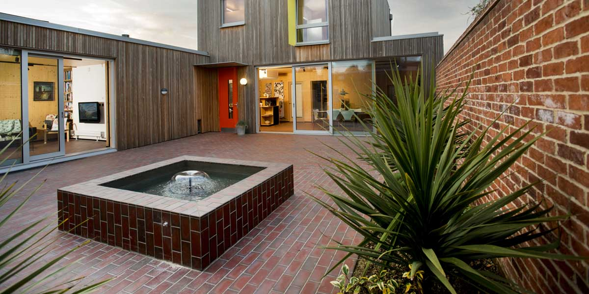 a mixed blend of light and dark multi quarry tiles at a Passiv house in Hampshire