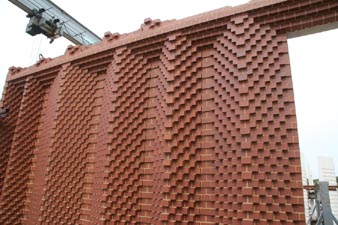 a range of red special bricks create a stunning precast panel case study
