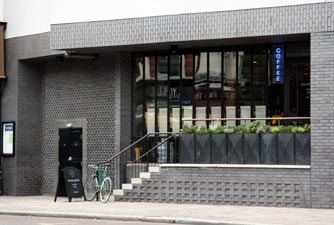 combination of Ketley Staffs Blue Facings and brick slips create aTrendy London Cafe