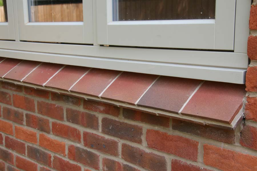 country brown sanded tiles used as creasing tiles for an external cill