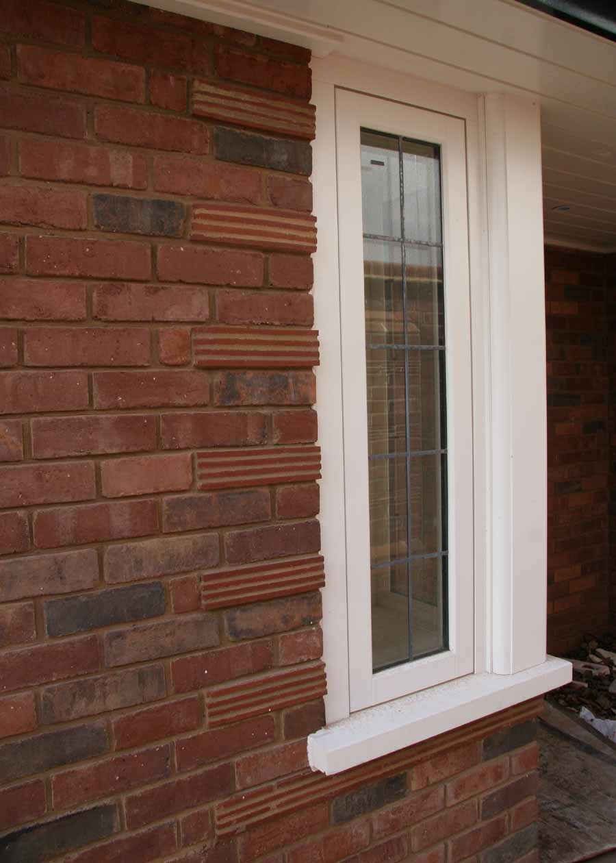 creasing tiles are used here to add detail to the brickwork around the window