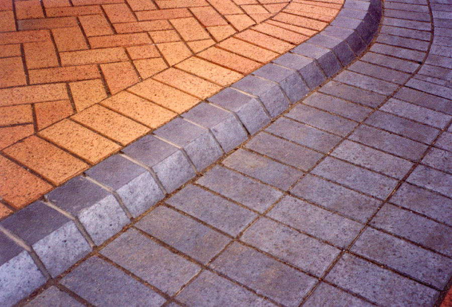 kerb and plain blue pavers