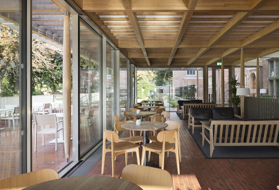 light multi quarry tiles merge inside and out at the new cafeteria pavilion Jesus College Cambridge