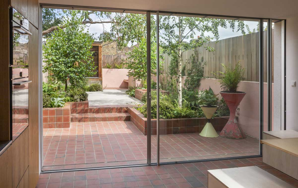 light multi square quarry tiles unite the indoor and outdoor space at a Hackney garden