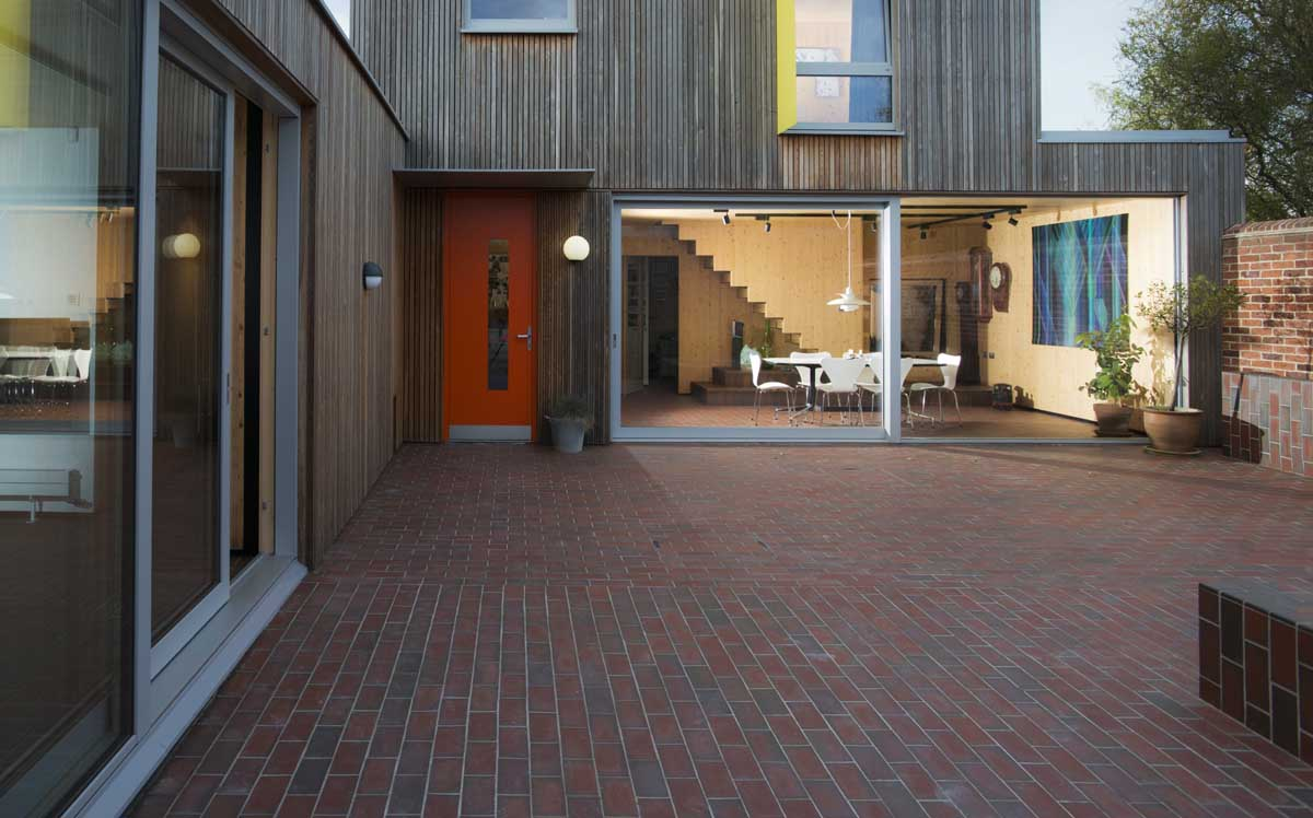 quarry tiles in dark and light multi unite the indoor and outdoor spaces